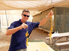 Robby holding up Iraqi dates (quite tasty too); Camp Victory