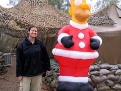 Becky next to a Homer Simpson blowup doll as soldiers decorate their living areas for Christmas; Balad