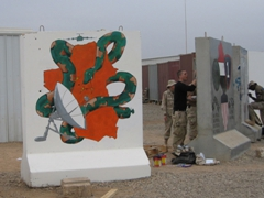 Soldiers tasked to beautify the T-wall barrier near the Balad DFAC