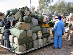 Bags getting palletized for an outbound flight; Iraq