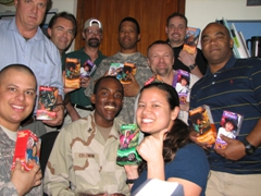 It's girl scout cookie time! Sean, Greg, Dave, John, Bossie, Ivan, Larry, Gil, Coleman, & Becky pose for a thank-you photo for Barb from JIEDDO