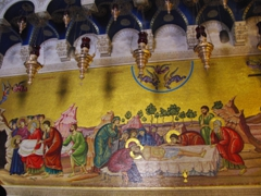Wall mosaic of Jesus' burial at the main entrance to the Church of the Holy Sepulchre. This church is the site for the crucifixion, entombment and resurrection of Jesus Christ and has been carefully sectioned off into Greek Orthodox, Roman Catholic, Armenian Orthodox, Coptic, Syrian and Ethiopian Churches; Jerusalem
