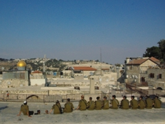 Israeli soldiers soak up the ambience of Jerusalem from a rooftop in the Armenian Quarter