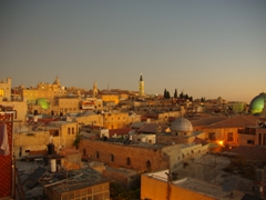 The old city of Jerusalem takes on a soft glow as the sun sets over this majestic and wonderful city