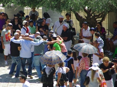 Jews dancing, singing, and chanting to a loud accompaniment of music just outside the Western Wall; Jerusalem