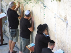 "Men praying before the Western (aka ""wailing"") Wall; Jerusalem"