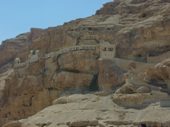 The 12th Century Greek Orthodox Mount & Monastery of Temptation clings to cliff face. This was where Jesus spent 40 days and 40 nights fasting and meditating during the temptation of Satan; Jericho