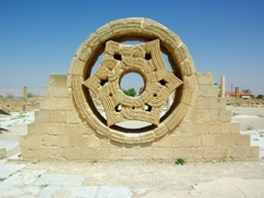 This hexagonal star, built of sandstones inside a circular frame, is believed to be an upper window to Hisham's Palace. It is a fine example of early Islamic architecture