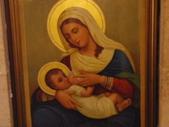 A painting of Mary feeding baby Jesus; Milk Grotto Chapel in Bethlehem