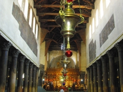 The main nave of the Church of the Nativity; Manger Square in Bethlehem