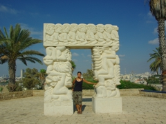 A sweaty Becky poses beneath the archway of the Faith Monument; Old Jaffa