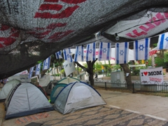 Israeli flags on proud display during this street protest against the high costs of accommodation; Rothschild Boulevard in Tel Aviv