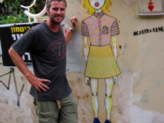 Robby poses next to a girl on a wall; Tel Aviv