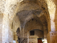 Entrance to the Hospitaller Fortress, a series of atmospheric vaulted halls located about 25 feet below street level in Old Akko