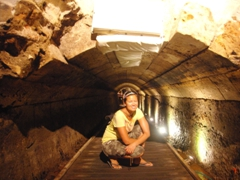 Becky strikes a pose inside the Templar Tunnel which is low in some places, forcing us to a low crouch; Akko