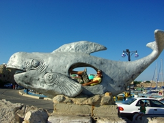 Becky clowning around inside this whale sculpture at Akko Harbor