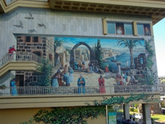 A realistic wall mural painted on a side of a building in Tiberias showing how this Sea of Galilee town used to appear centuries ago