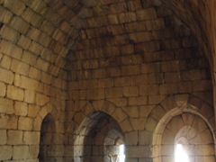 A massive vaulted prison beneath the southwestern tower; Nimrod Fortress