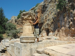 Becky beside an old column near the Temple of Pan; Banias Nature Reserve