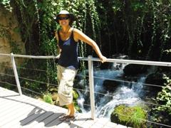 Becky smiles beside a gushing Hermon stream; Banias Nature Reserve