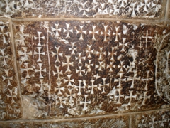 Carved cross graffiti inside the Church of the Holy Sepulcher; Jerusalem
