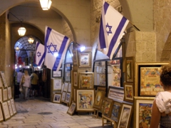 Israel flags wave proudly on the Cardo, a well heeled section of the Jewish Quarter with beautiful artwork and jewelry for sale; Jerusalem