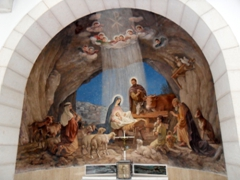 Wall mural of the shepherds visiting baby Jesus; Shepherds' Fields Church near Bethlehem