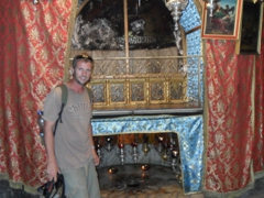 Robby beside the site of Jesus' birth, located in a cave of the Church of the Nativity. The star inset in the marble marks the exact spot of Jesus' birth in the cave; Bethlehem