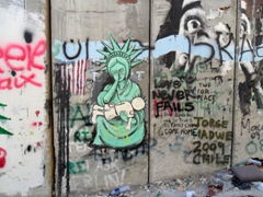 A depiction of the Statue of Liberty crying on the Israel/Palestine Security Wall