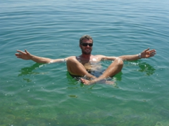 Robby assumes a cross legged pose while floating in the Dead Sea
