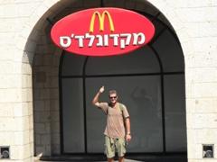 "Robby beneath a Hebrew ""McDonalds"" signpost; Tel Aviv"