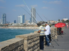 Fishermen trying their luck on the walkway from Old Jaffa to Tel Aviv