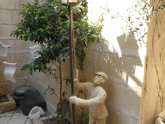 A statue lighting a lamp post outside one of Old Jaffa's artist homes