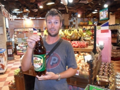 Robby holding up a super sized 2 Liter bottle of beer; Tel Aviv