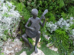 A guitar strumming boy sculpture in the Ursula Malbin Sculpture Garden; Haifa