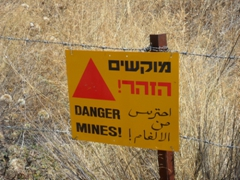 A warning sign about the danger of mines; Golan Heights near Banias Waterfall
