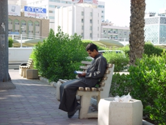 Boy reading the Koran in Kuwait City