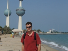 Robby chilling on the beach in front of the Kuwaiti Towers