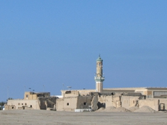 A mosque minaret dominates the skyline in this remote section of town