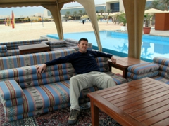 Robby chilling by the pool at the Kuwait Hilton