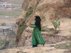 Young girl offering a cactus pear, Bayt Baws