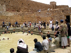 Boys taking a dip in the pool beside Thula's most famous mosque