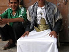 "A young man in traditional Yemeni attire, complete with ""jambiya"" (the short, curved dagger that all Yemeni men wear)"