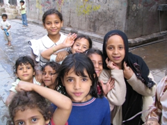 Excited girls posing for a photo (sura) in old Sana'a
