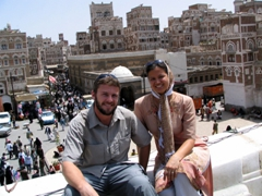 Robby and Becky sitting on Bab al Yemen, Sana'a