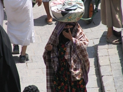 This woman hails from the outskirts of Sana'a, as her colorful attire reveals