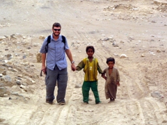 Young boys on the welcome wagon to Old Marib, grabbing Robby by his hand and giving him a first rate tour