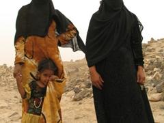Bedouin women posing in Old Marib