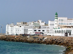 Scenic harbor view of old Mukalla city