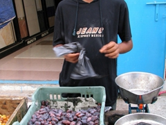 What a bargain! Boy selling a kilo of dates for only 50 cents, Mukalla